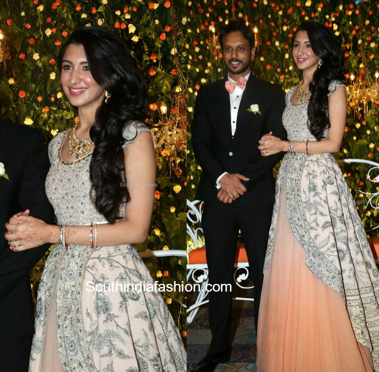 Gulnar in a lovely cut away gown for her wedding reception.