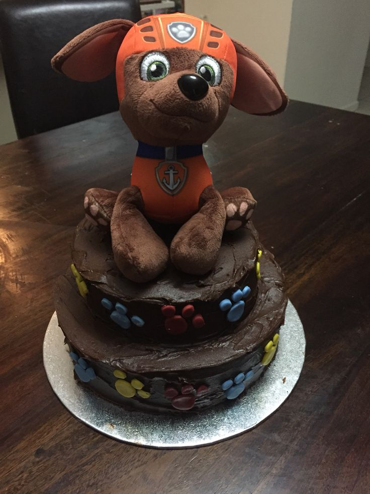 Zuma cake. Fondant paw prints with zuma toy on top. Simple paw patrol cake. Made paws with piping tip for big circle & pen cap for little circles.