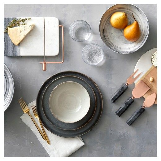 Form meets function with modern, Scandinavian-inspired serveware. The mixture of material, texture and tone—wood, copper, gold, ceramic, porcelain and real marble—creates elegantly embellished surfaces that wow. Find bowls, plates, cheese boards and more.