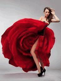 Анимация Девушка в красном платье в виде распускающейся розы танцует оголив ножку, гифка Девушка в красном платье в виде распускающейся розы танцует оголив ножку