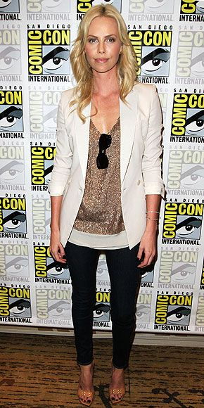 Tailored white blazer, embellished top and black cigarette pants.  Nude pumps.