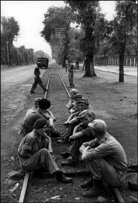 Henri Cartier-Bresson // Indonesia, 1949 -- Java.  Dutch soldiers waiting for order to evacuate Solo.