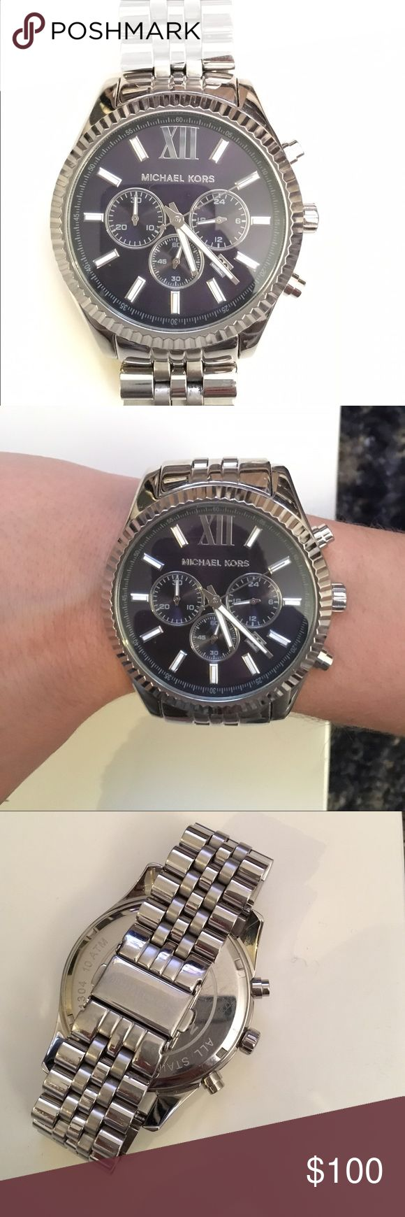 Michael Kors Silver Tone Navy Face Watch Michael Kors Silver Tone Navy Face Watch. In excellent condition, rarely worn. Custom sized to a small wrist, can be readjusted with added links and battery replacement in any Michael Kors store locations. Michael Kors Accessories Watches