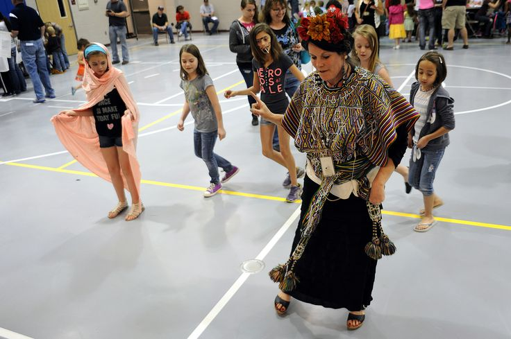 """Art teacher Angie Reid provides Salsa dance lessons May 2 during """"Celebrate the Arts Family Night"""" at Remington Elementary School in Falcon School District 49. Sponsored by the school's PTA, the evening tied in the school year's social studies units, while exhibiting hallways filled with kindergarten-fifth grade creativity, according to Reid, who coordinated the event."""