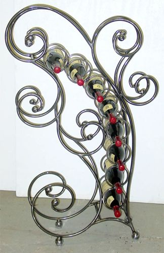 Lovely Wrought Iron Wine Rack!  Visit stonecountyironworks.com for more beautiful wrought iron designs!