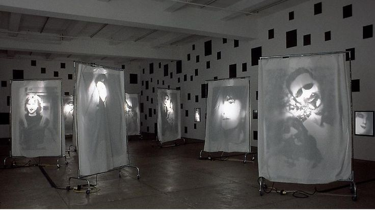 Boltanski, Christian - This is a nice idea of how I could present my work. I like that he puts the lights behind the fabric too because it gives it a more spooky effect which could work well with my theme of characters.