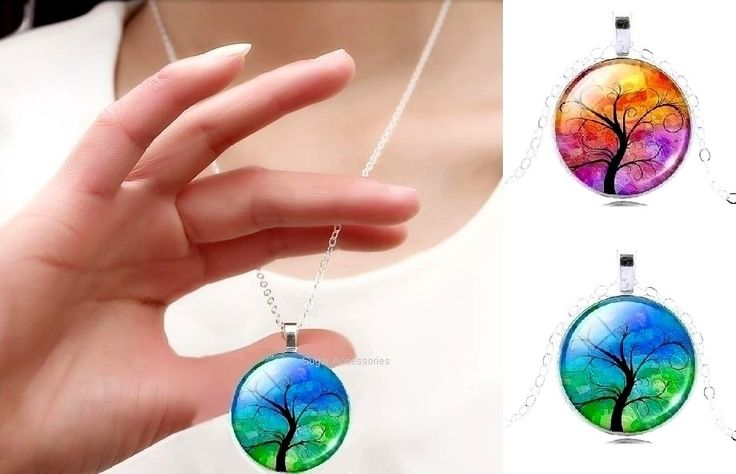 A beautiful colourful Tree Of Life glass dome cabochon pendant necklace.