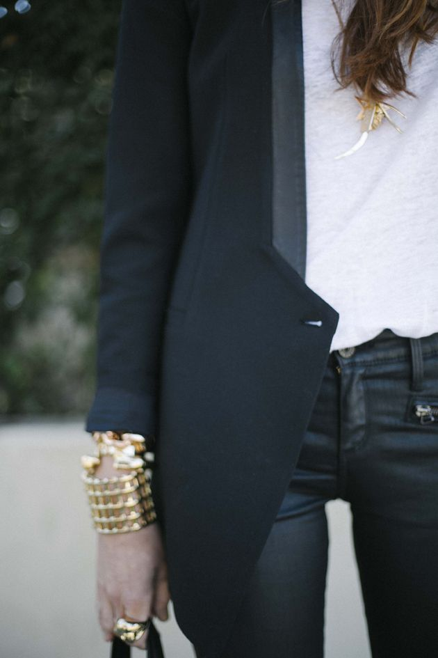 Leather jeggings and a polished blazer with a simple white tee and gold accessories.