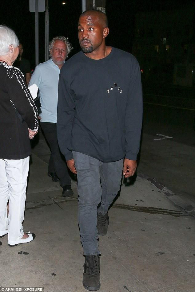 Kanye West wearing The Life of Pablo Paris Crewneck Sweatshirt, Yeezy Season 3 Military Boot and Acne Studios Ace Used Cash Slim-Fit Jeans