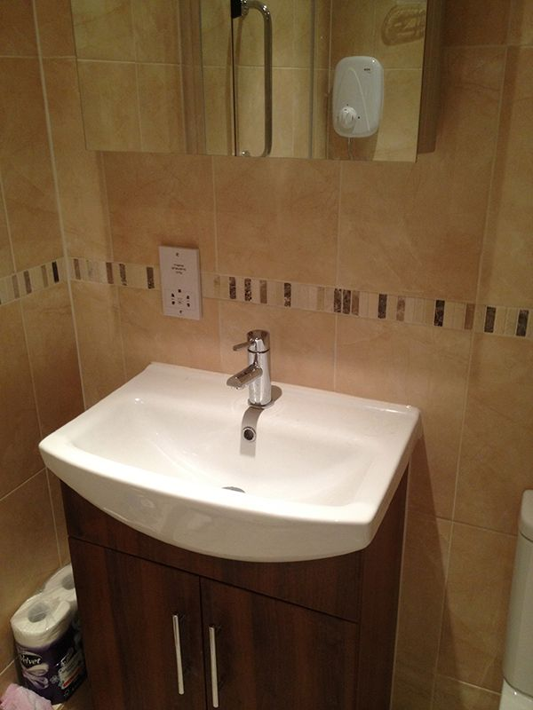 Picture Gallery Website Ceramic Tiling With Stone Mosaic Border in a bathroom installation by UK Bathroom Guru