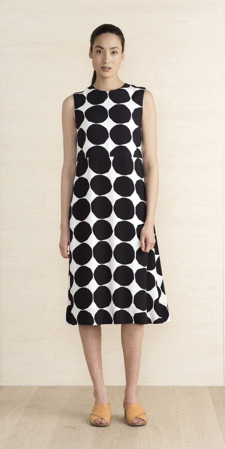"MARIMEKKO ONANDA DRESS - BLACK, WHITE    This sleeveless dress made of viscose crepe has a straight cut that flares towards the below-knee hemline. It's lined, has a high waistline seam, and hidden back zip closure. The classic Pienet Kivet (Small Stones) print is featured in black and white.  A size 38"" measures 45"" from the shoulder seam to the hemline.  Material: 100% viscose  #dress #matisse #pirkkoseattle #pirkkofinland #spots #polkadots #blackandwhite #wedding #graduation"