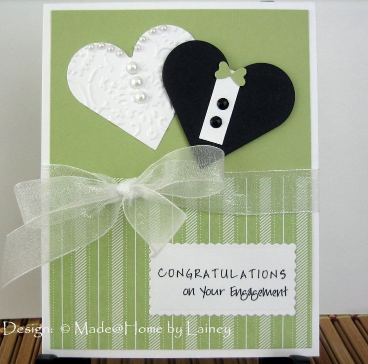 I like the idea of using hearts as bride and groom on a wedding card