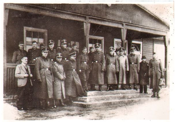 On 25 February 1944 the Auschwitz commandant Arthur Liebehenschel informed that the chief of the Central Construction Office SS-Sturmbannführer Karl Bischoff had been awarded the War Merit Cross 1st Class with Swords for his constributions to victory through his work in construction.  The Birkenau camp, four crematories and gas chambers as well as hundreds other camp buildings were constructed under Bischoff's direction. In the picture: Karl Bischoff's staff (Bischoff: 4th from the right).