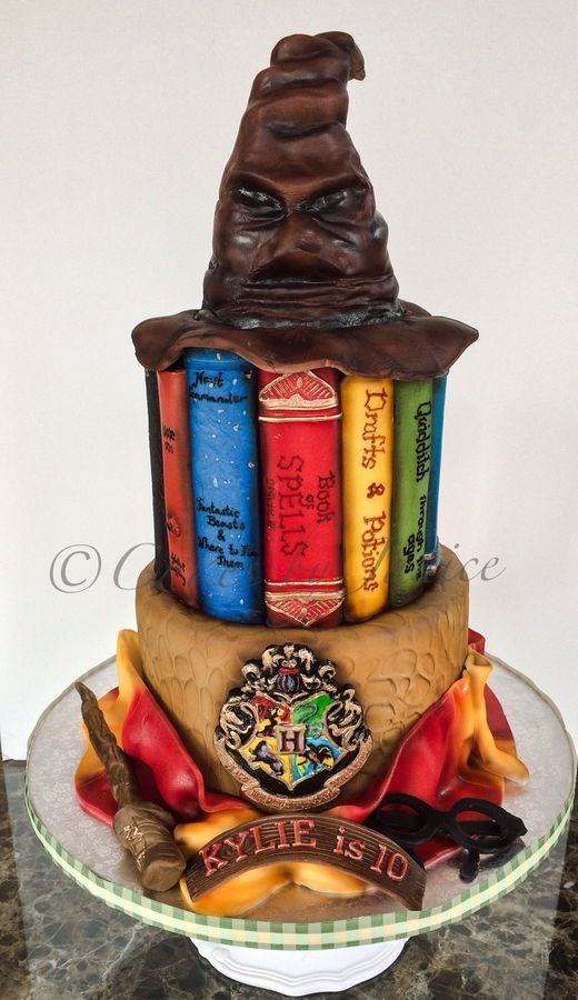Harry Potter themed 6 and 8 inch cake. Wand, eyeglasses, scarf and Hogwarts emblem is fondant. Sorting hat is fondant with styrofoam armature. Thanks for looking. h