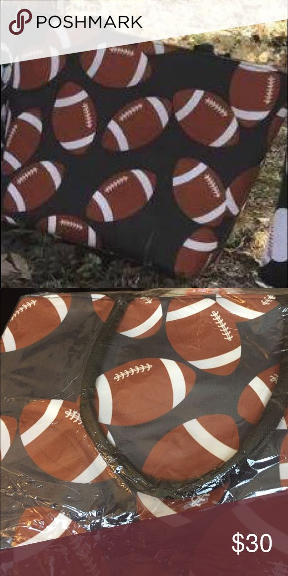 Football bag! 🏈 Brand new. Great bag for the sports mom! 17 3/4 x 13 x 5 1/2 Nylon handles and zipper closure. One zipper pocket inside. Beautifully treated canvas for stain resistance, stability and longevity. Bags Shoulder Bags