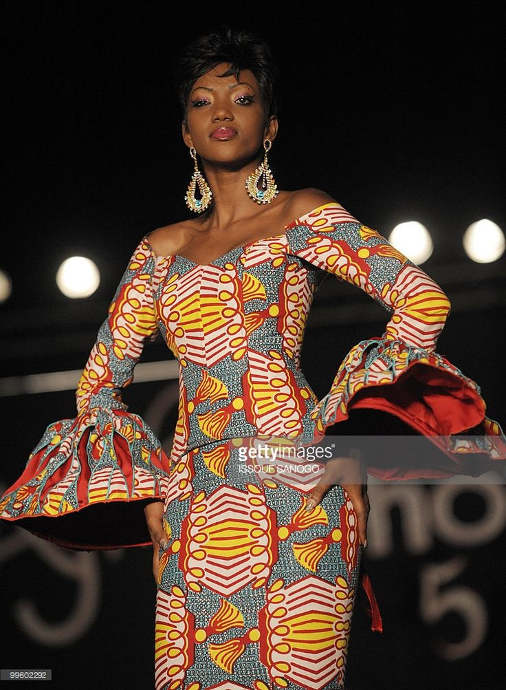 A model presents a creation on the catwalk during the closing of the 5th edition of 'Afrik Fashion' in Abidjan on May 15, 2010. Designers from Benin, Burkina Faso, Togo, Senegal and Ivory Coast attended the 5 day long African fashion trade show and presented their latest creations.