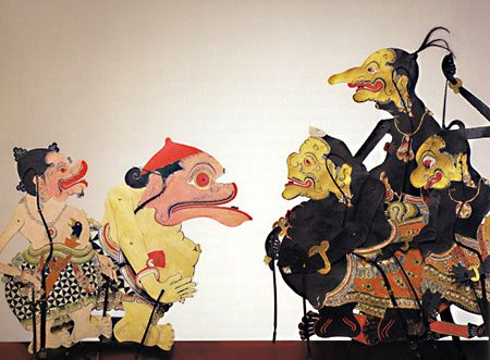 Wayang Kulit Puppet. My mother was born in Indonesia, & she owned a shadow puppet that looked rather like the tallest one here. It provided me with TONS of 'nightmare fuel' as a child (& still does!).