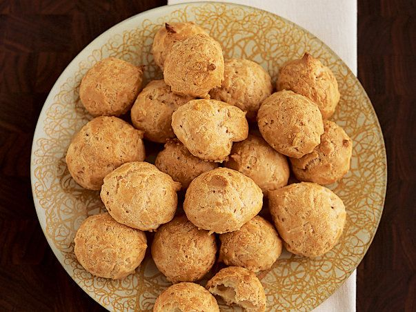 Alain Ducasse's Gougères | Alain Ducasse's recipe for gougeres. These airy French cheese puffs, flavored with Gruyere cheese and a hint of nutmeg, make phenomenal hors d'oeuvres.