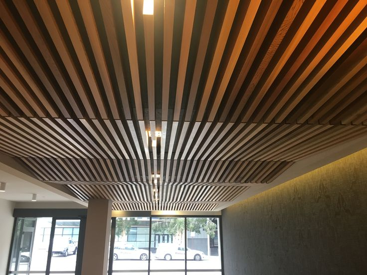 acoustic DecorSlat ceiling with raked design by Decor Systems #rakedceiling #timberceiling #unqueceiling #slattedceiling #decor #decorsystems #acousticceiling