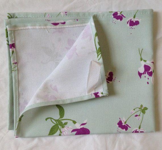 Purple tea towel   purple fuchsia flowers on  green tea