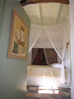 Ethnic-Minimal-Bedroom-Unique-Tiles-Wood-Cloth-Paintings-Santorini-Greece