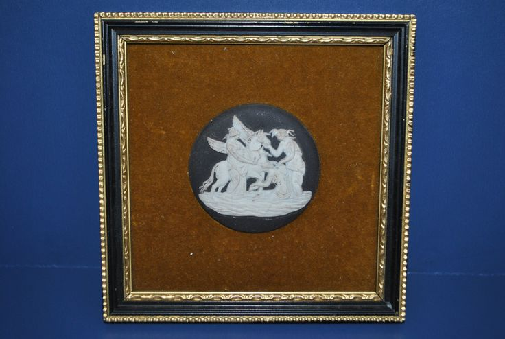 Vintage Wedgwood jasperware black framed medallion in good condition depicting a traditional neoclassical scene.