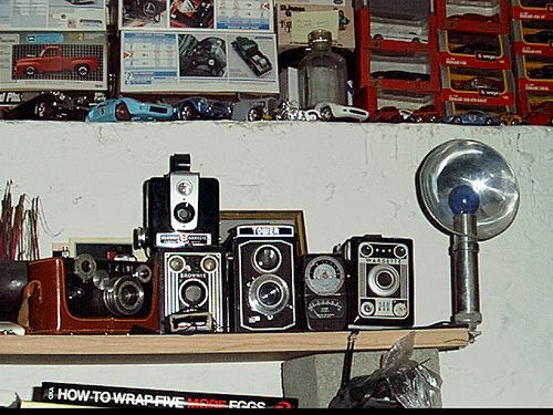 this was my camera collection way back when. it grew some before I had to leave it behind in the US moving to Italy hasn't been easy but I w...