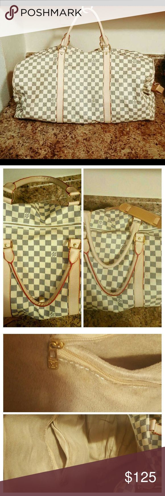So nice Big Louis bag for Travel It is such a beautiful new white checker Damier Louis Vuitton style bag. It is great for travel to carry all your nice clothes. It is such good price  better than Louis Vuitton price and still so nice you will love it. Along with is included a long strap for comfortable shoulder carry and nice clean new inside. Thank you so much for support! 😊 Louis Vuiiton Bags Travel Bags