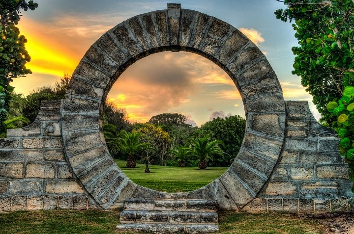 Moongates are a common feature in Bermuda gardens. It is regarded as a symbol of love and Bermudians believe people who walk through a Moong...