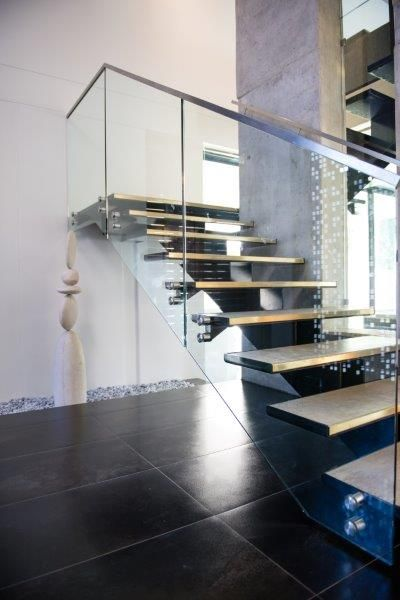 custom mild steel staircase, custom treads and glass balustrades