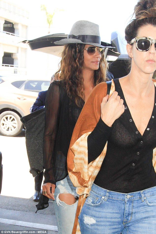 Chic and cheerful!Layering up, the star also donned a sheer cardigan, whilst she flashed glimpses of her tanned and toned pins in a pair of distressed bleached jeans