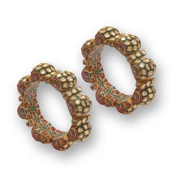 This exquisite pair of bangles is crafted in 18k gold and set with polkies surrounded by sea- green enamel.