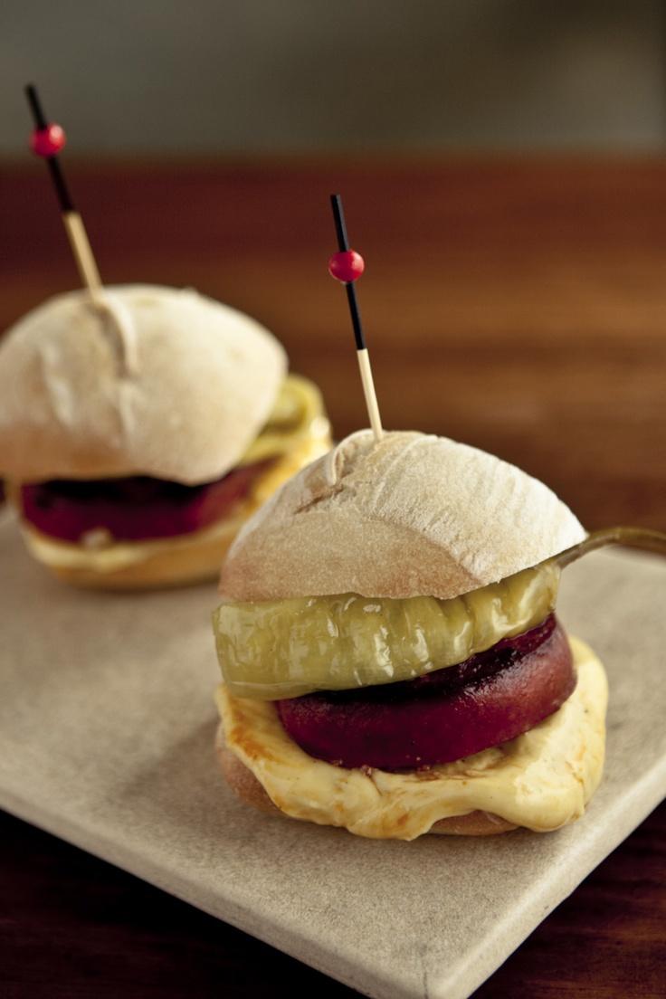 Bocadillos de chorizo. Tapa of little spanish sandwiches.