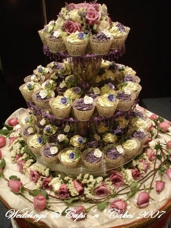 Wedding cake and cupcake decorating ideas cup cake towers for Cup decorating ideas