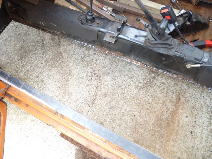 To remove the remainder of the floor use a chisel or air chisel to break the factory spot welds leaving the lip where your new floor will sit. Once removed clean up with a flap disk in a grinder and spray the lip with a zinc based weld through primer.