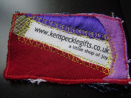 Patchwork business card for a gift shop to communicate that everything is hand made.