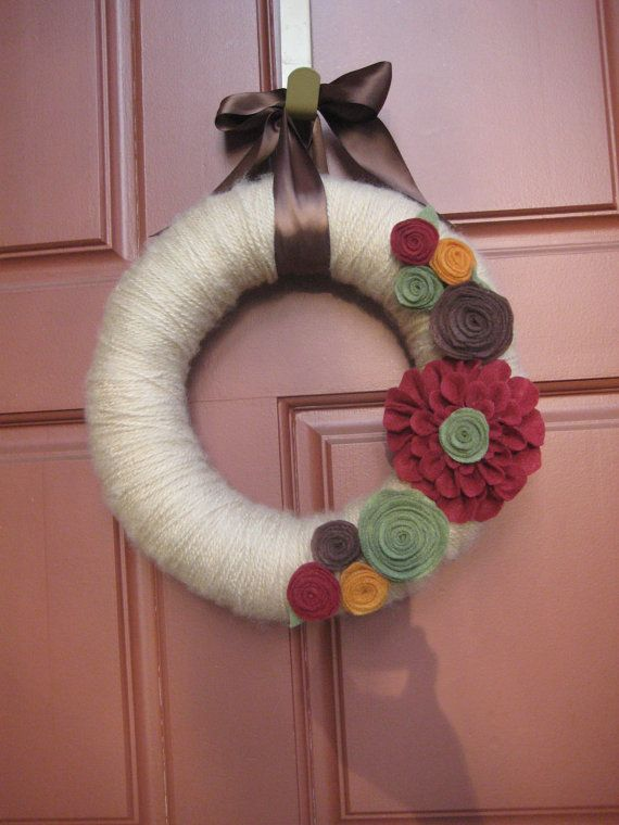 Hey, I found this really awesome Etsy listing at http://www.etsy.com/listing/98233112/beautiful-earth-tone-yarn-wreath-with