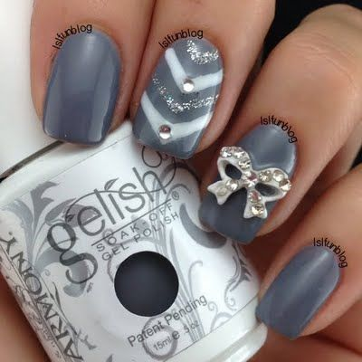 Industrial slate grey gets a bling treatment with silver, rhinestone studs and a bow in this nail design. Copy this nail art with these product suggestions.
