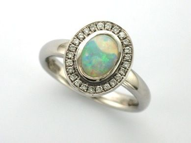 'HOLLY' --  Stunning Engagement Ring set with Opal surrounded by Halo of Accent Baby Diamonds  Custom made in 14ct White Gold