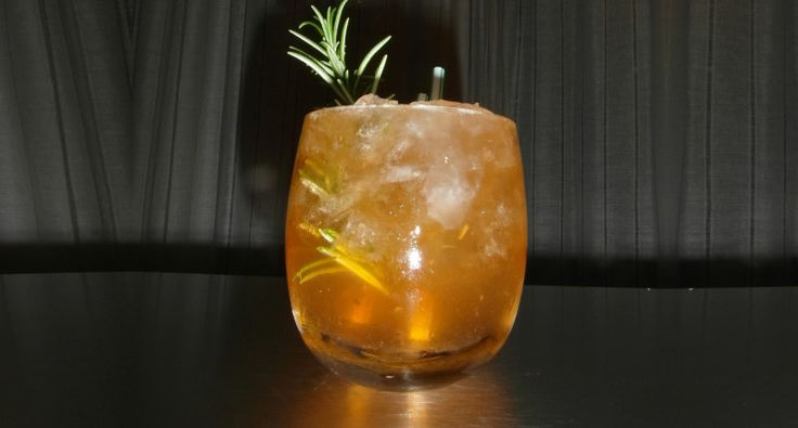 the scot's tipple: scottish whisky, irn bru, lemon, and rosemary