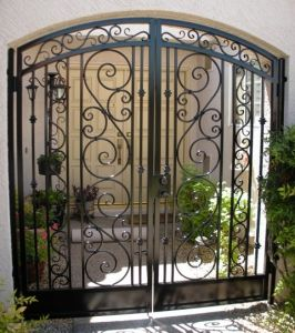"""Courtyard Iron fence - fancy curved """"Italian scroll"""" work and nice looking."""