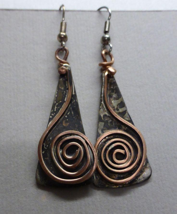 Noela Mills wabi sabi jewellery. Recycled heat treated metals, copper wire.