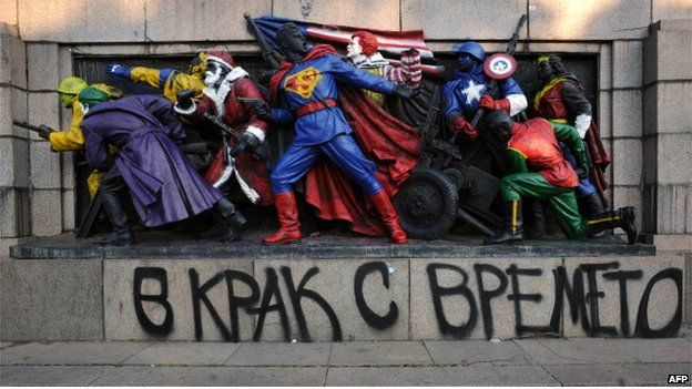 Action heroes, Santa and Ronald McDonald adorn a Soviet monument in Sofia (17 June 2011)