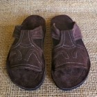 """""""Ody"""" sandals - named after a Haitian shoe maker who helped develop a business that employs survivors.  Sandals are made using recycled materials."""