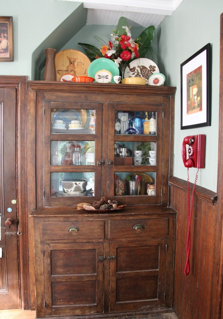 Dining Room Hutch With New Glass And Filled Colorful Accessories Oldhouseideas