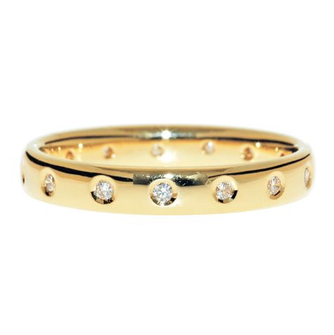 Round Brilliant Cut Diamonds Hammer Set In A Row Uniformly Spaced Around The Whole Band