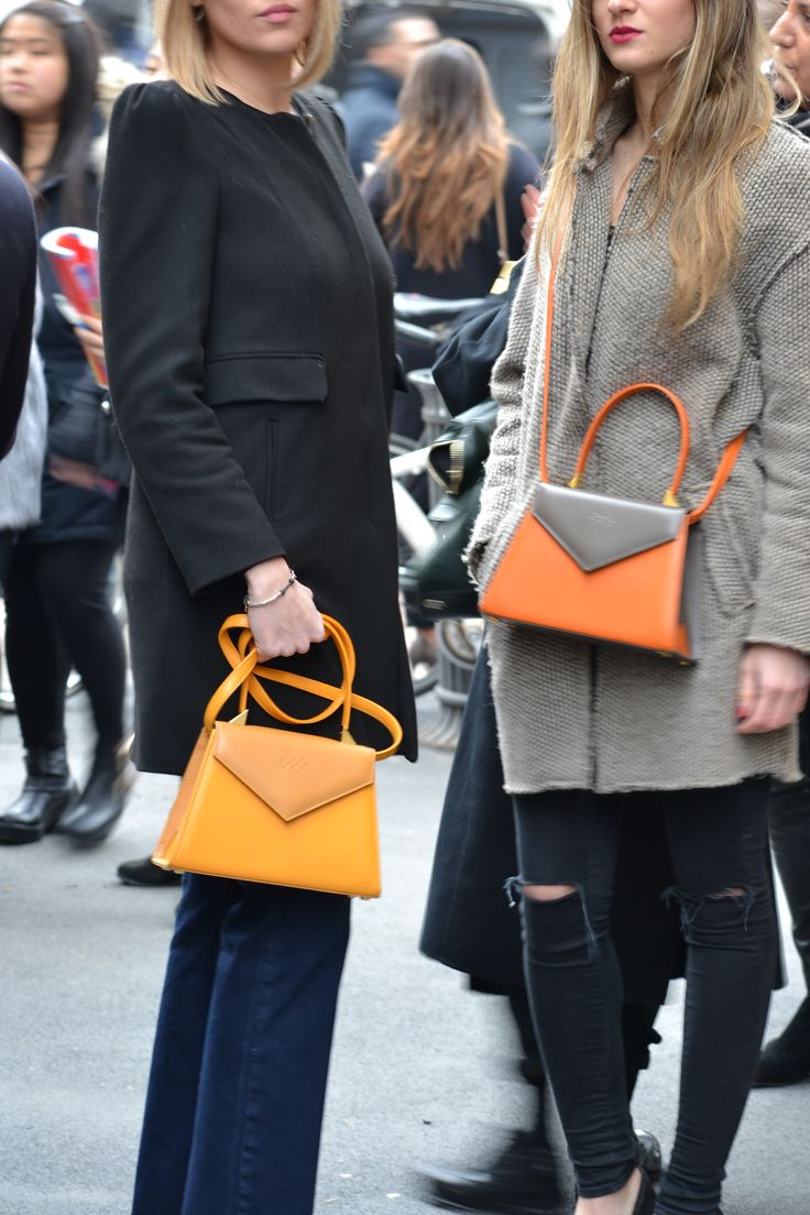Castamusa EDIE bags - Streetstyle at Milan Fashion Week.  Bicolor leather bags in yellow & mustard, Orange & Grey, Made In Italy.