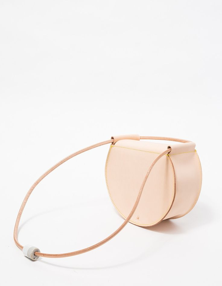 jujumade, a handmade vegetable tanned leather bag with porcelain bead closure