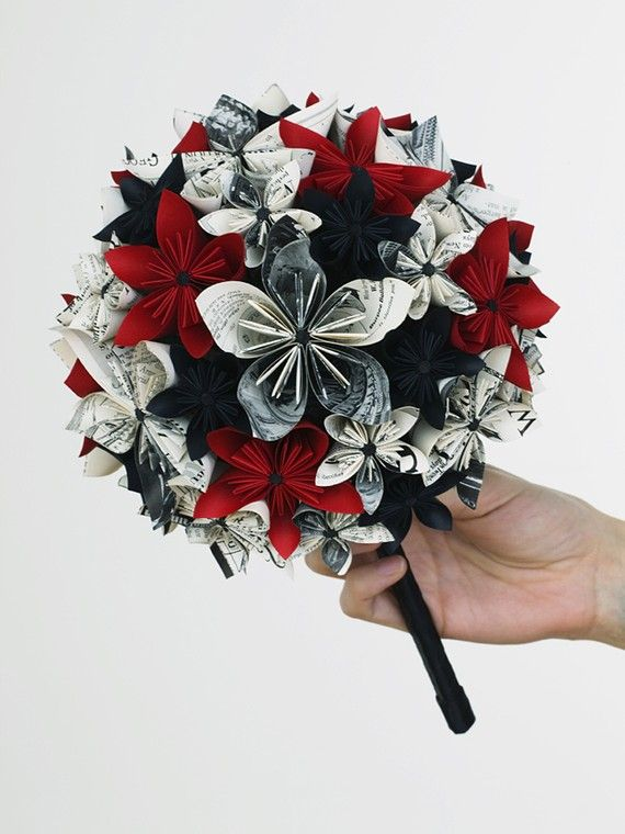 Paper Bouquet - that looks like it would take forever. How about a real one like this? Either mine and all the brides maids all red or the other way around.