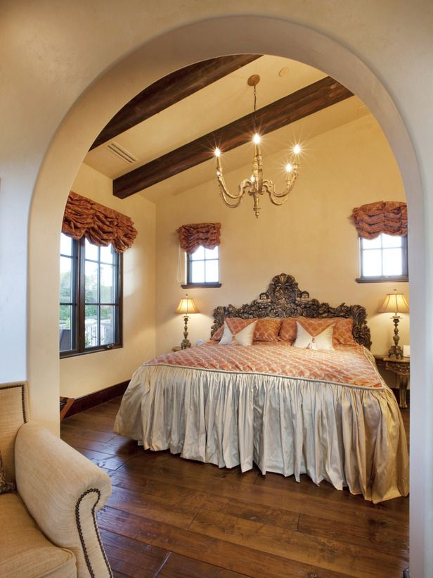 This master bedroom features a stunning headboard